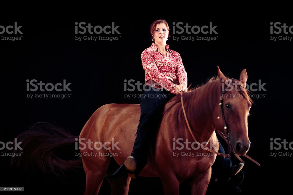 Cowgirl With Her Horse stock photo