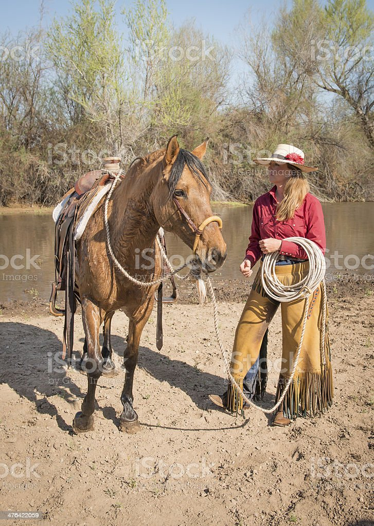 Cowgirl with horse by River royalty-free stock photo