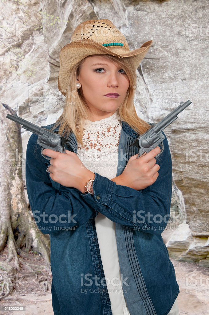 Cowgirl with relvolver stock photo