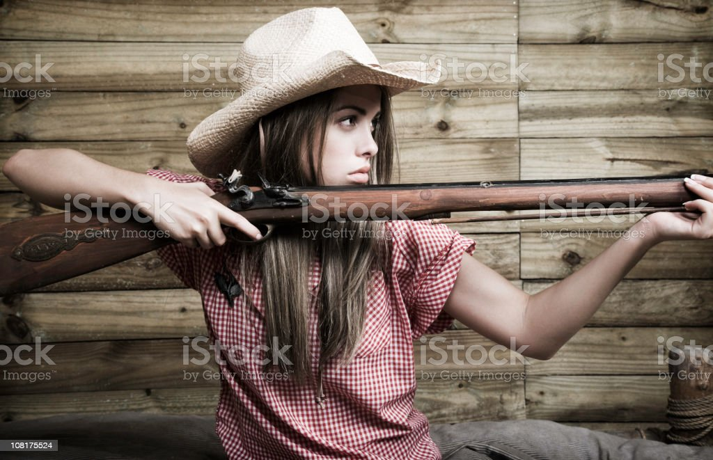 Cowgirl Woman Holding Rifle royalty-free stock photo