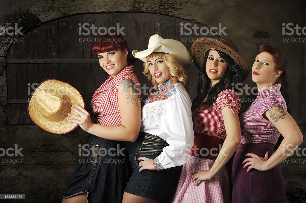Cowgirls chorus line against barn door stock photo