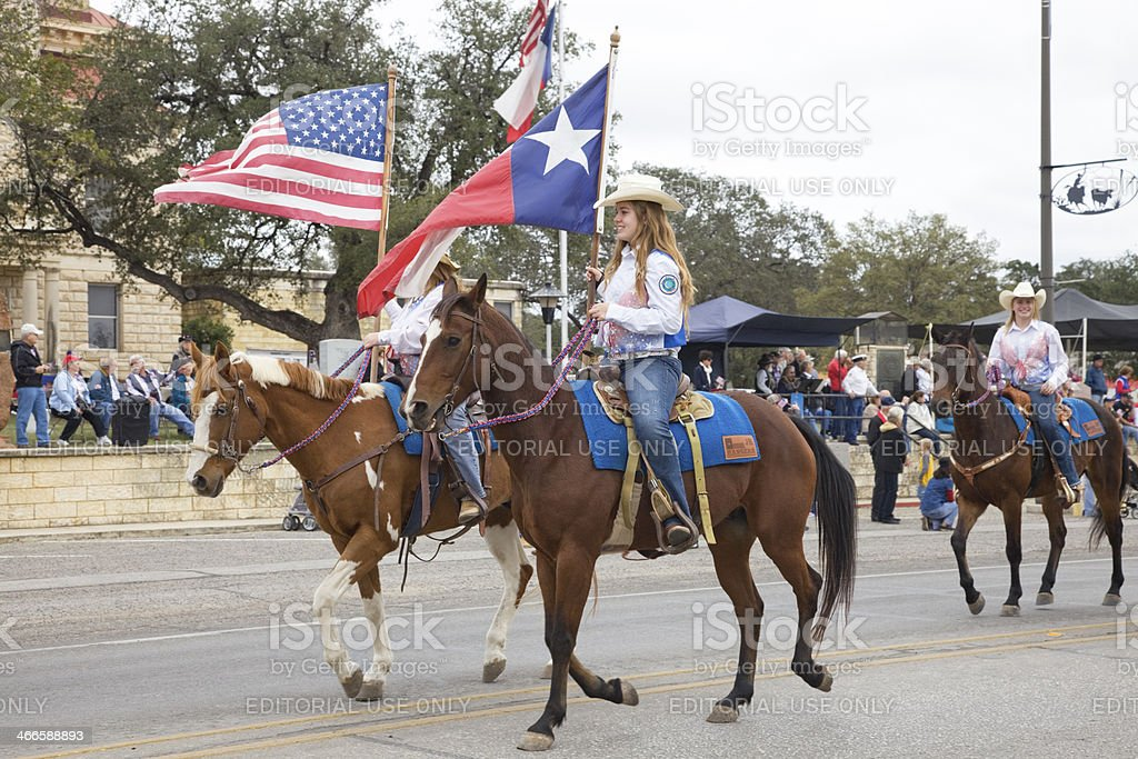 Cowgirls on horses, Bandera Texas Veterans Day Parade royalty-free stock photo