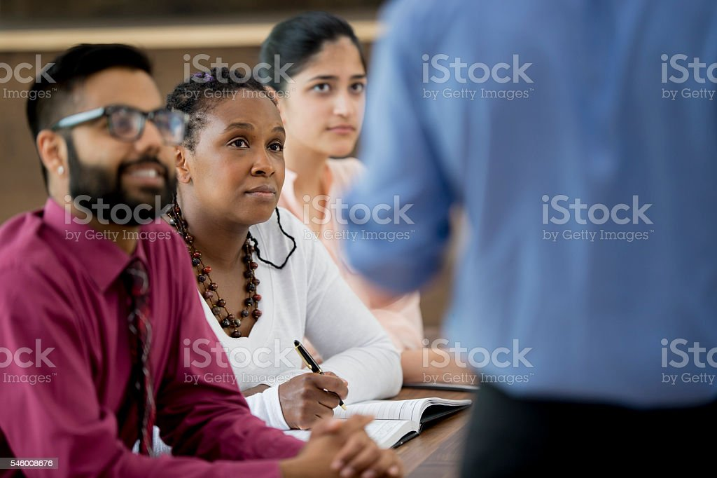 Coworker Leading a Team Meeting stock photo