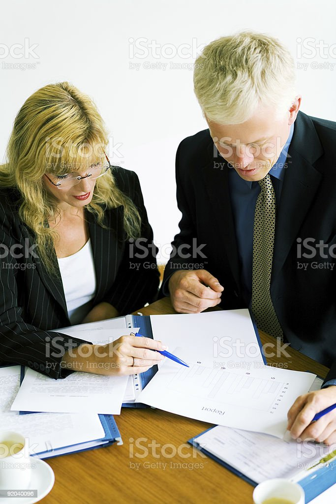 Coworkers analyzing reports and documents at table  royalty-free stock photo