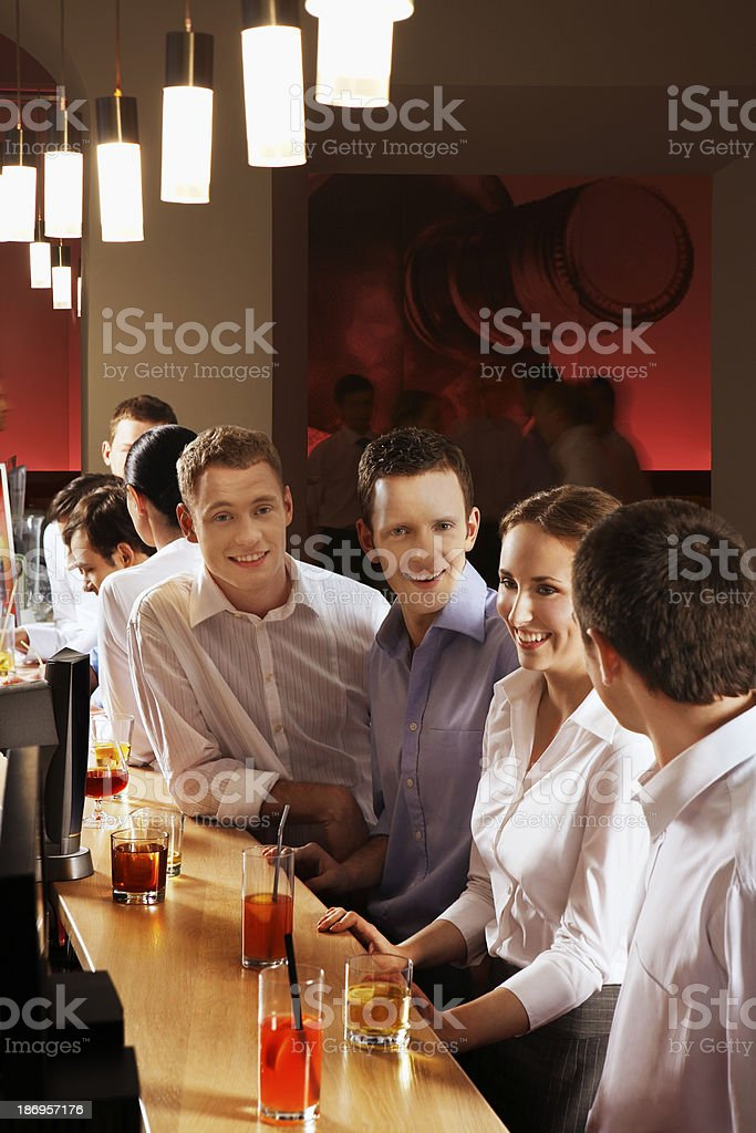 Coworkers at bar royalty-free stock photo