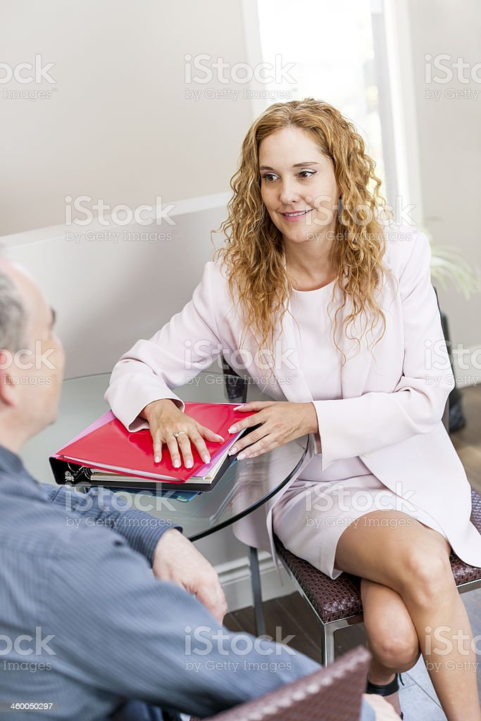 Coworkers at business meeting in office royalty-free stock photo