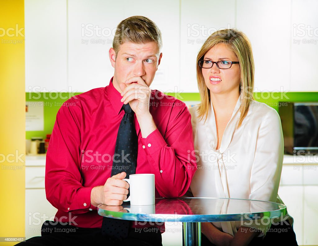 Coworkers criticize colleagues during coffee break stock photo