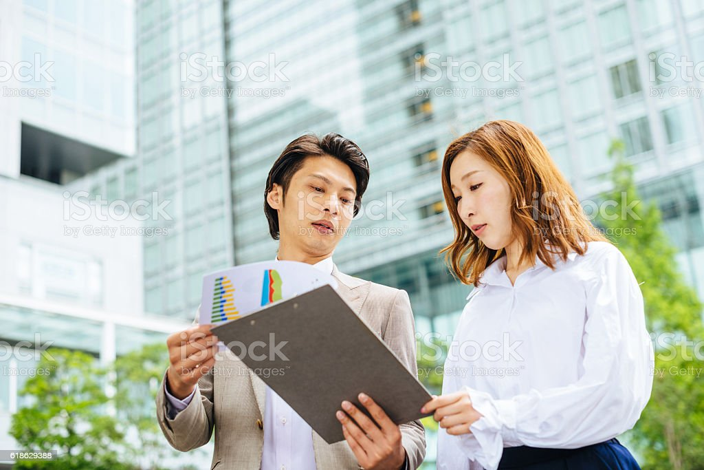 Coworkers discussing next business project and analyzing business data stock photo