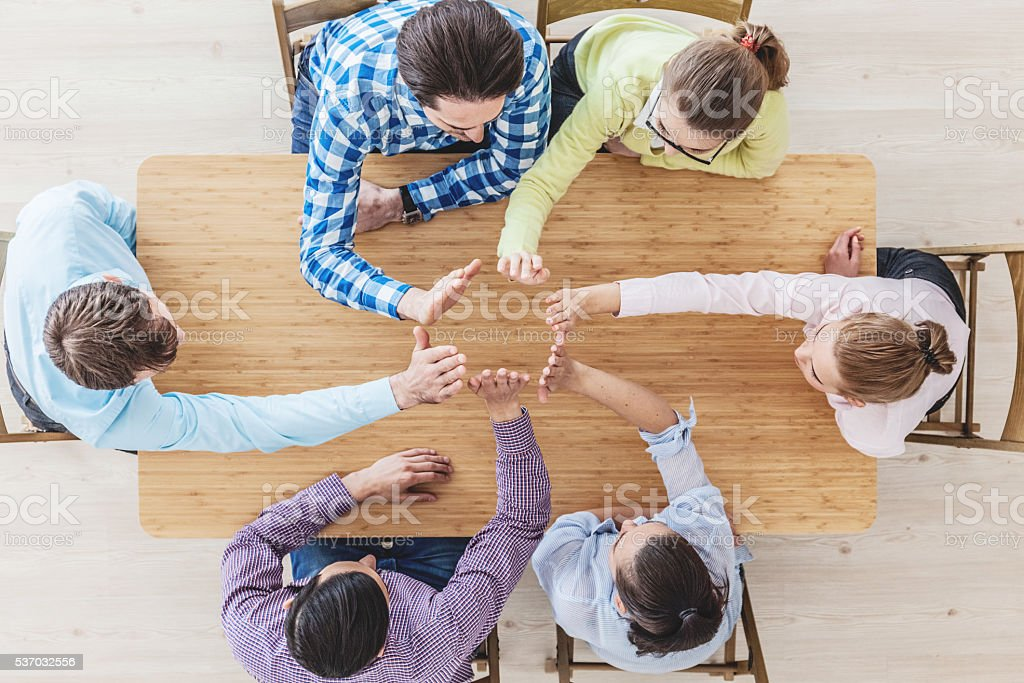 Coworkers doing high five stock photo