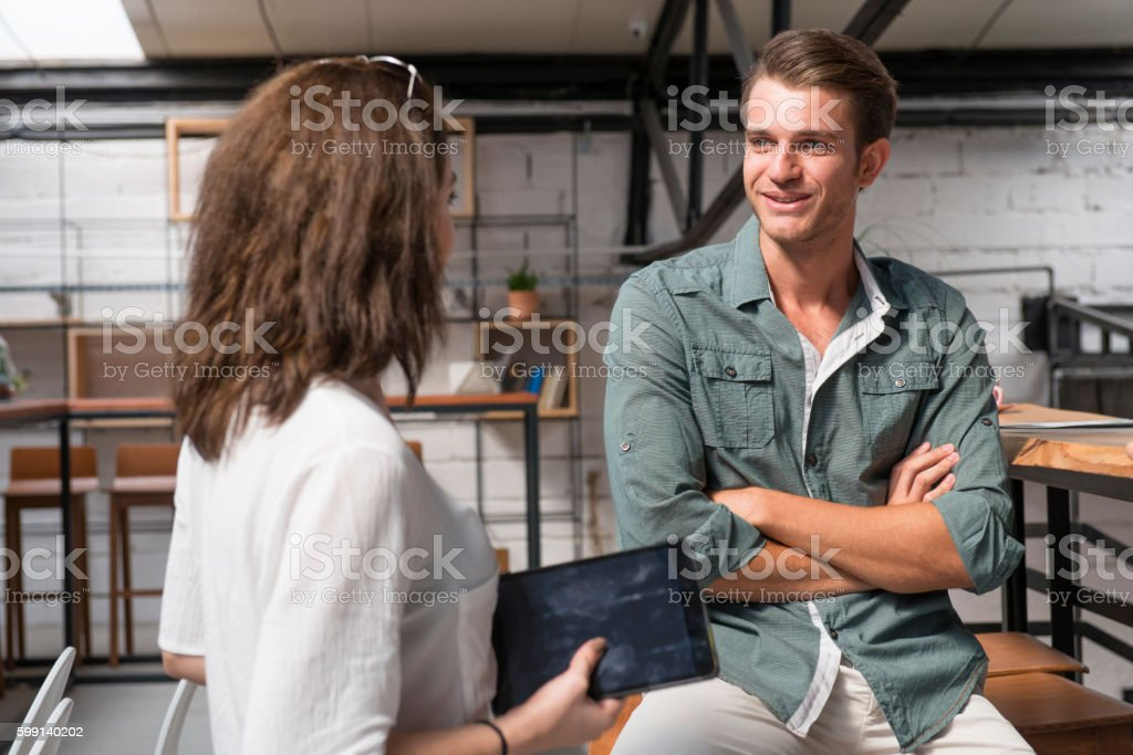 Coworkers having a conversation stock photo