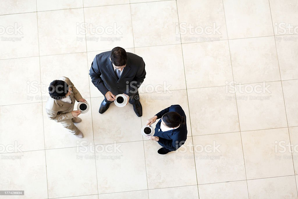 co-workers having coffee break royalty-free stock photo
