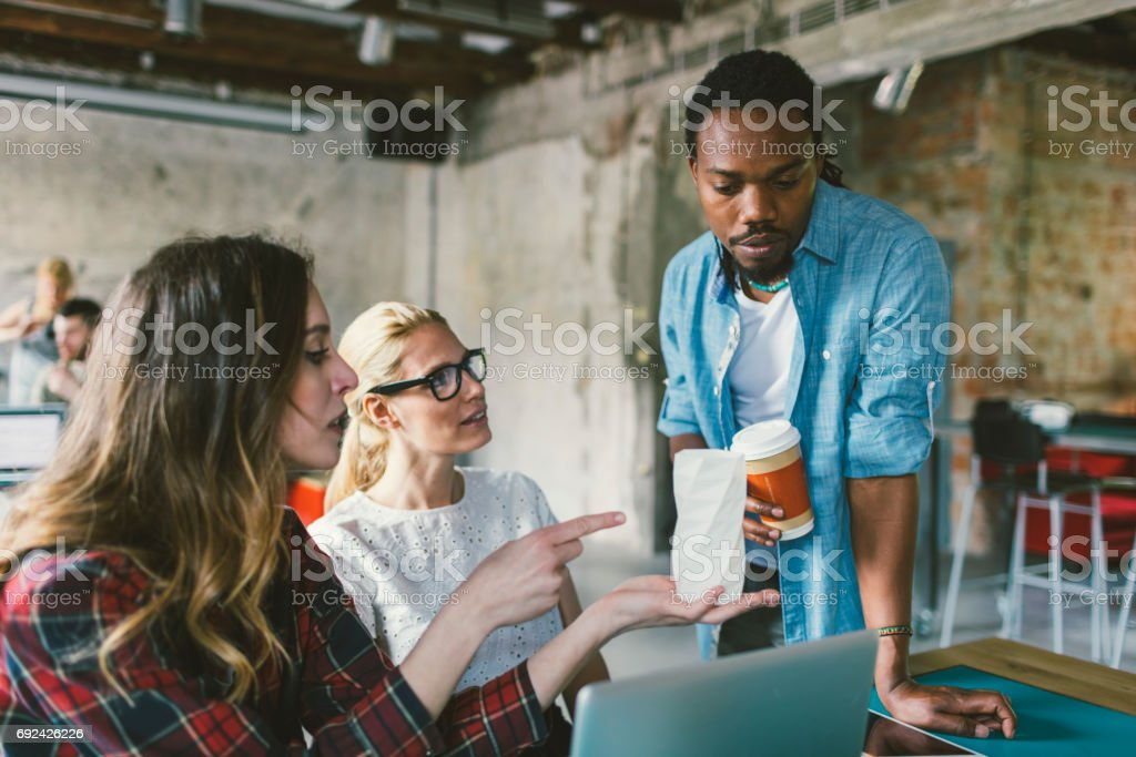 Coworkers in an open space office stock photo