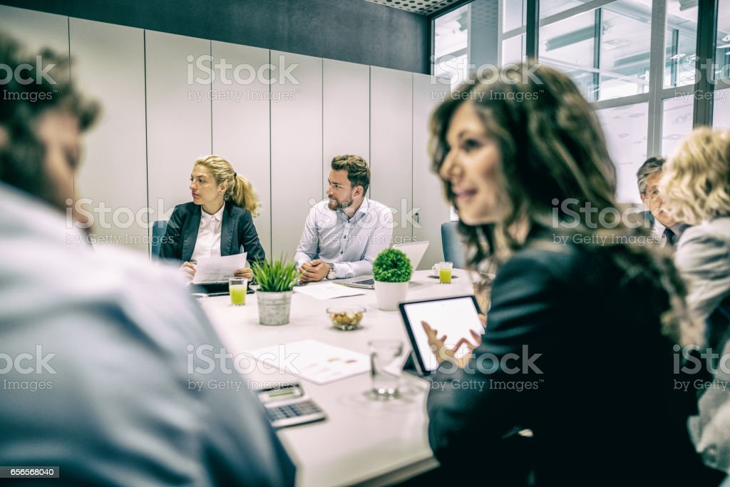 Coworkers in morning meeting in conference room stock photo
