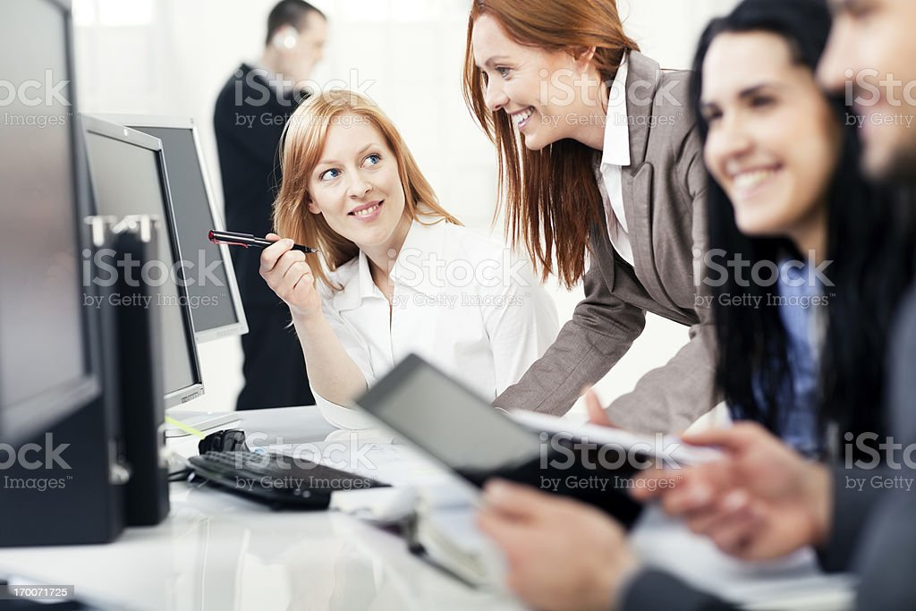 Co-workers in the office communicate, teamwork royalty-free stock photo