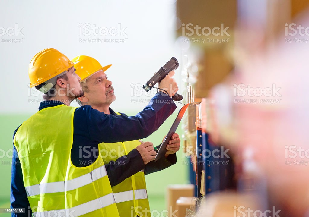 Coworkers in Warehouse stock photo