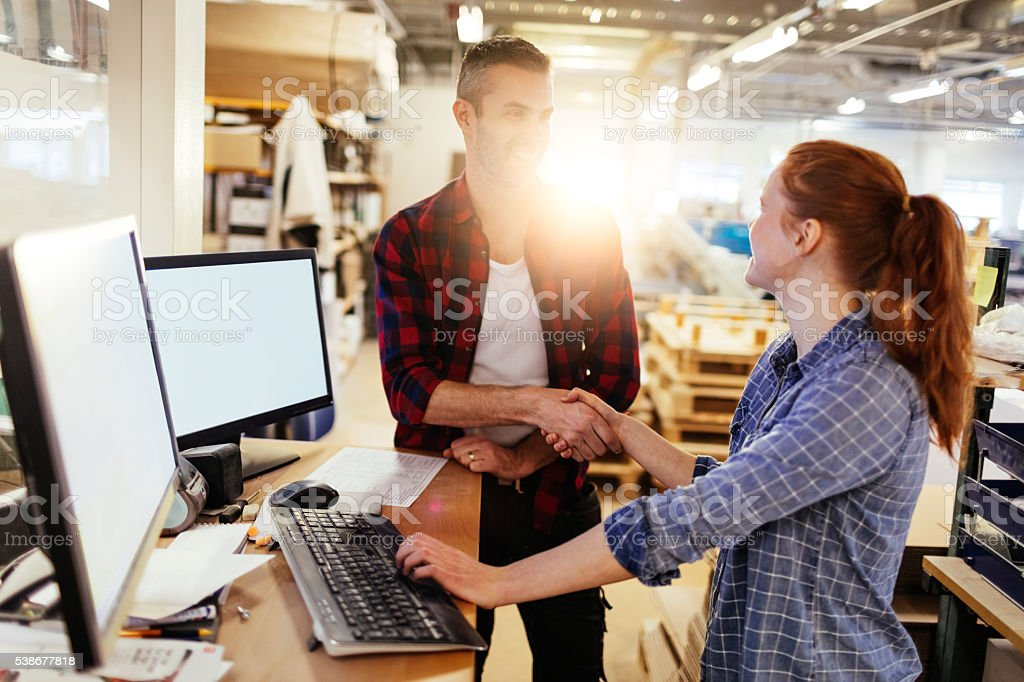Coworkers shaking hands stock photo