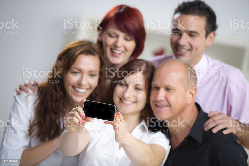 Coworkers taking picture of themselves royalty-free stock photo
