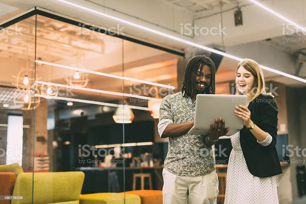 Coworkers talking in a modern office stock photo