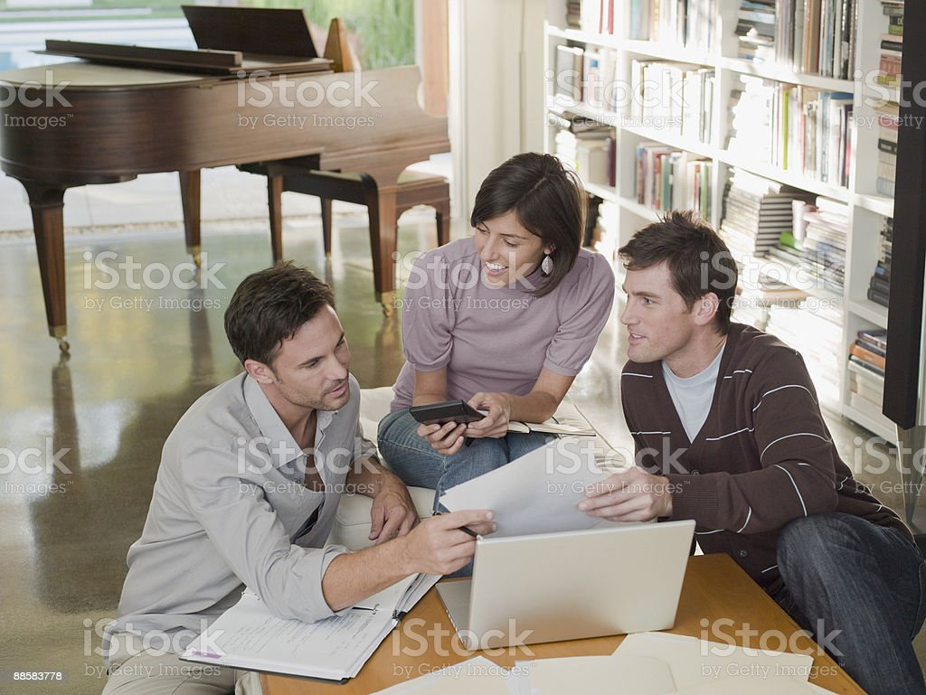 Co-workers working in home office royalty-free stock photo
