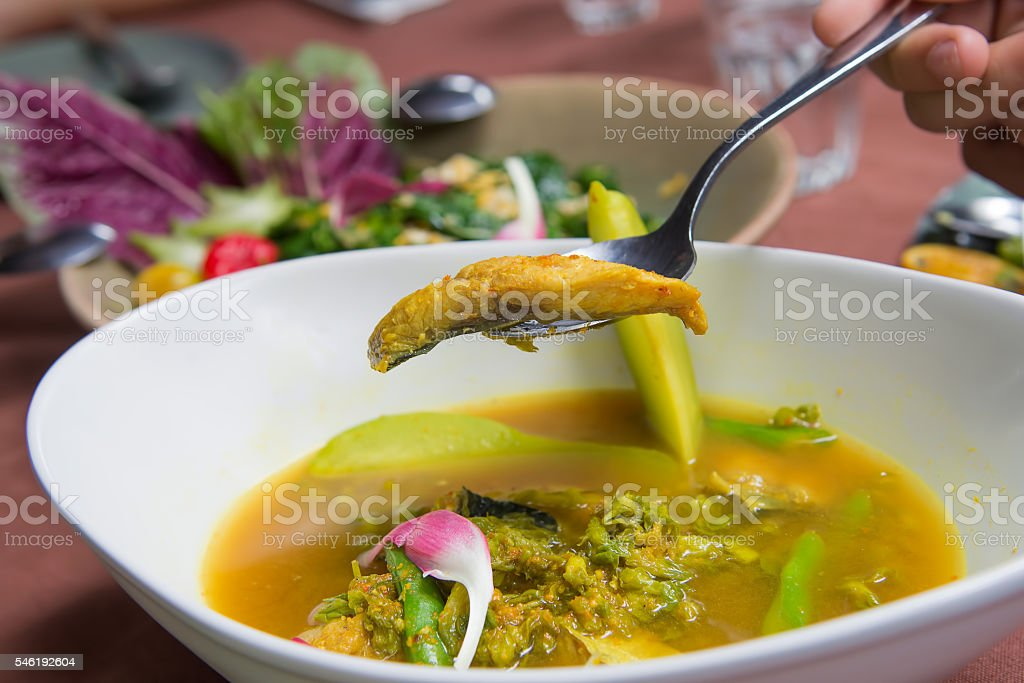 Cowslip creeper sour with fish in white bowl. stock photo