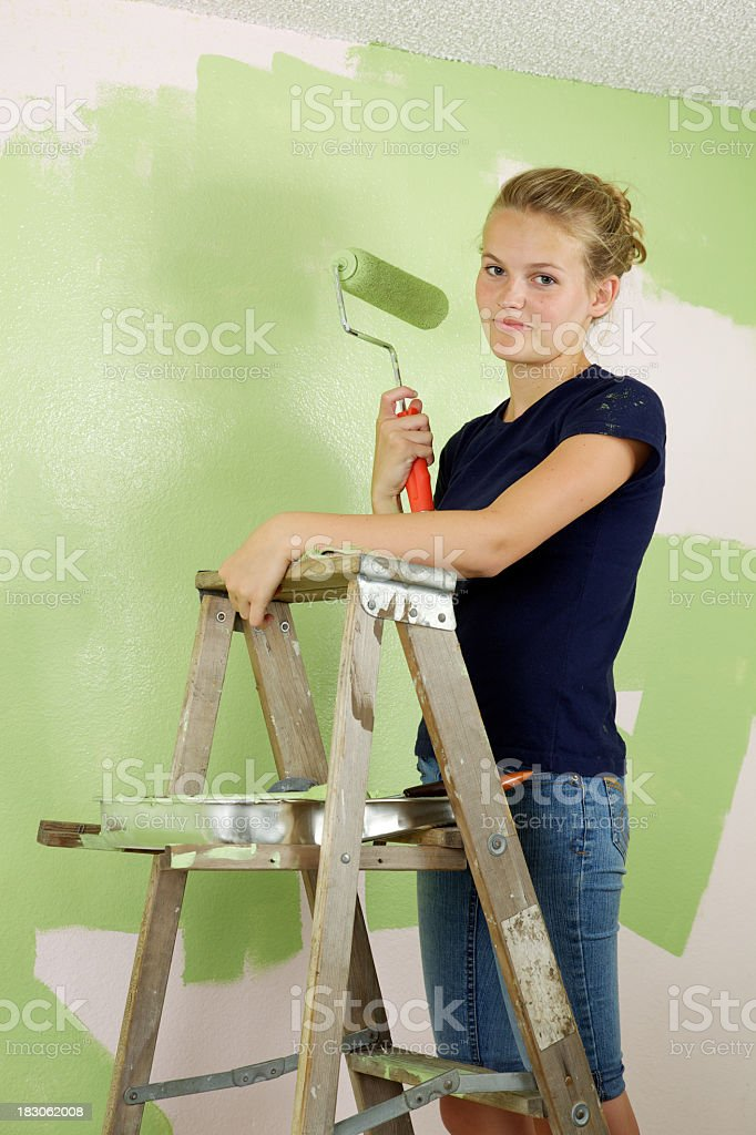 Coy Smile Painting Girl royalty-free stock photo