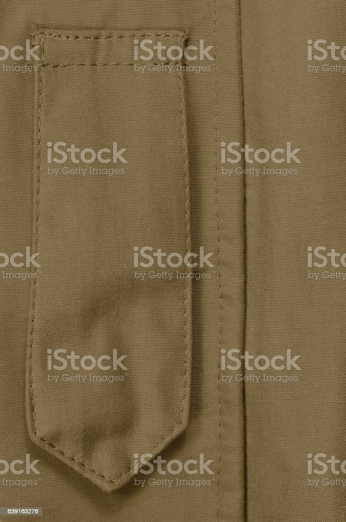 Coyote Tan ECWCS Parka Rank Insignia Badge Loop Closeup, Vertical stock photo