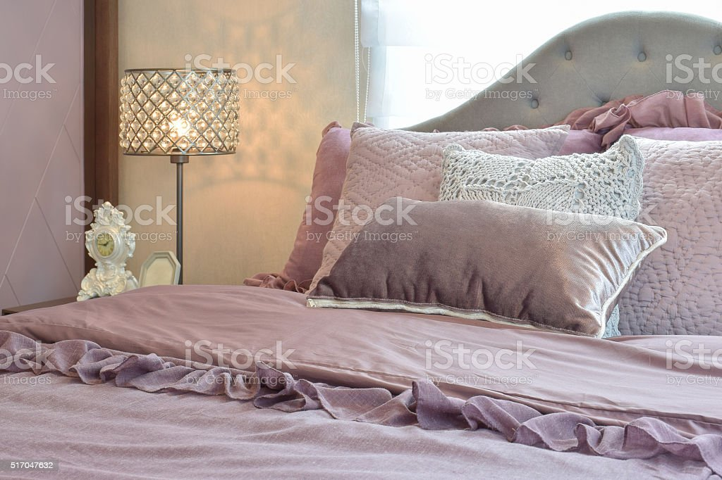 Cozy and classic bedroom interior with pillows stock photo