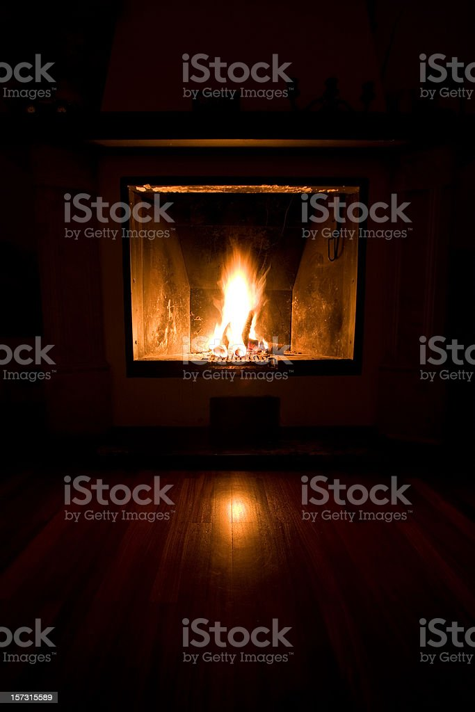 Cozy and warm home fireplace royalty-free stock photo