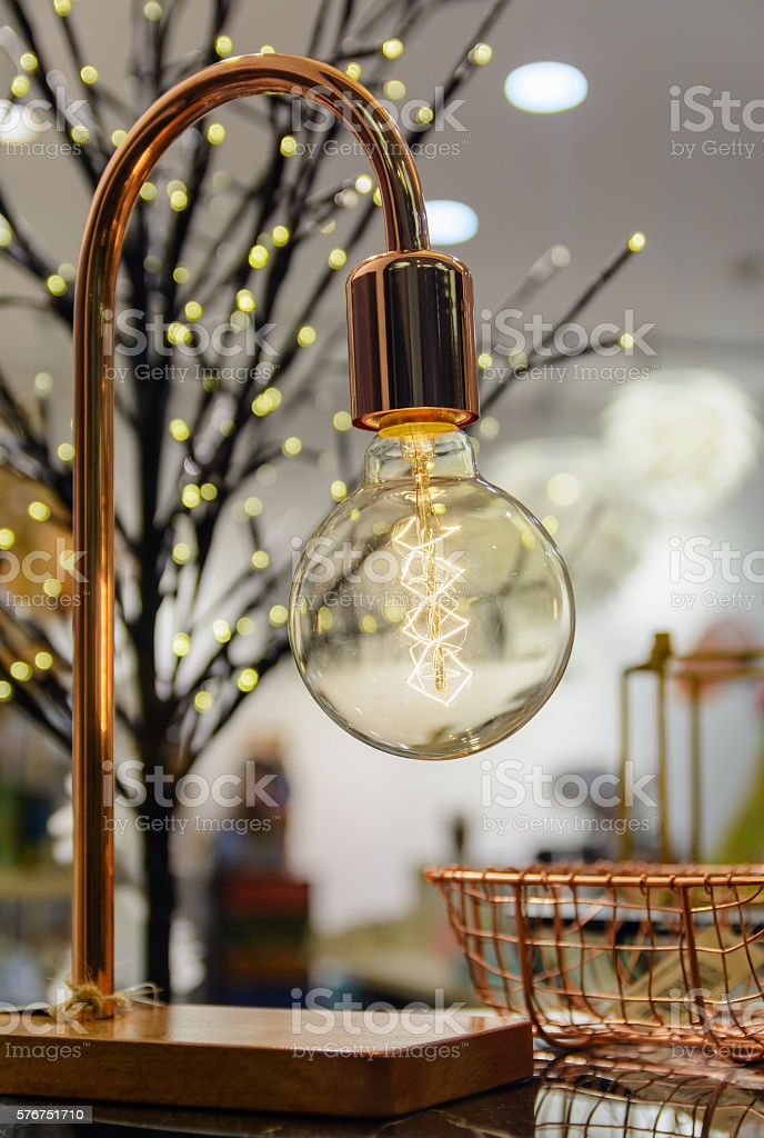 cozy atmosphere with a lamp Edison restaurants on  blurred background stock photo