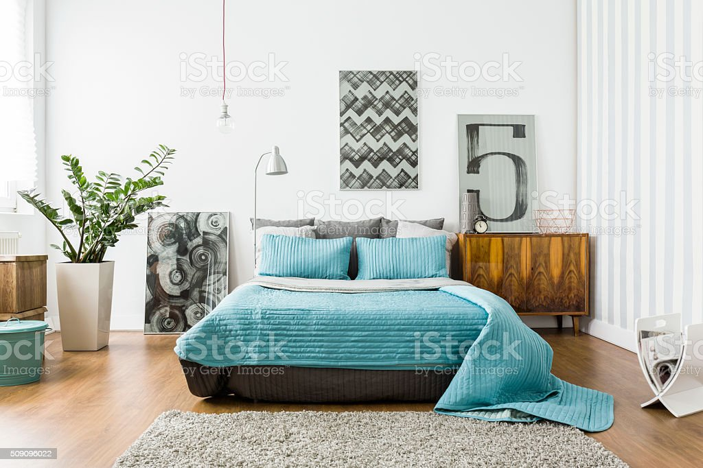 Cozy bedroom in modern design stock photo