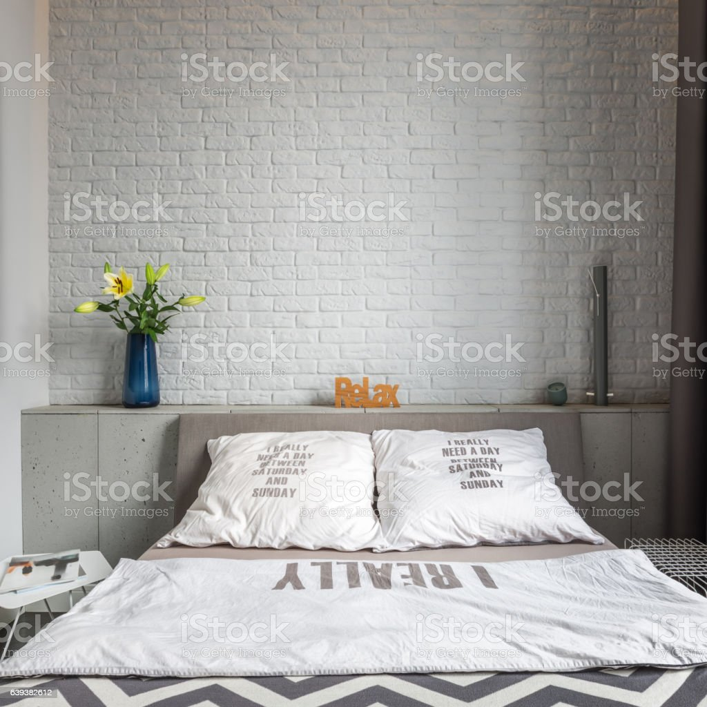 Cozy bedroom with double bed stock photo