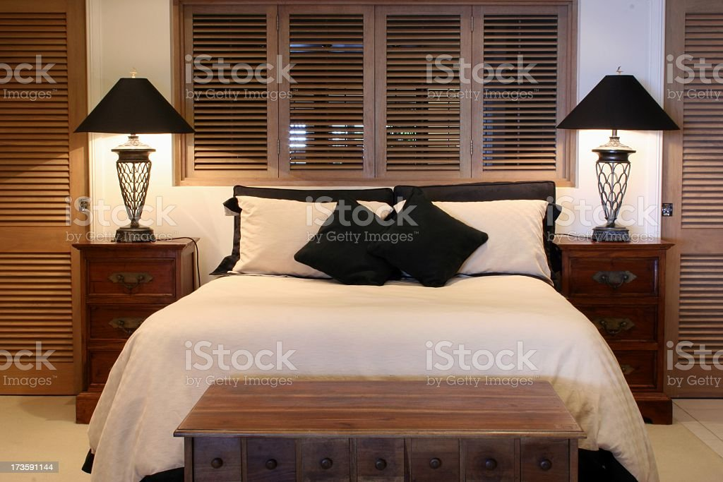 Cozy bedroom with white bedding royalty-free stock photo