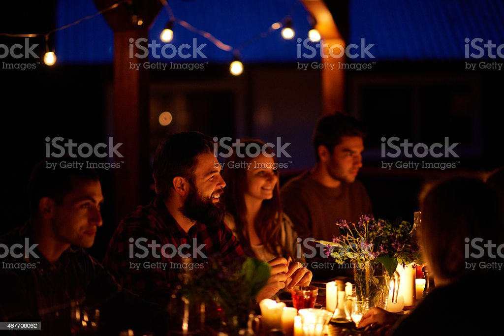 Cozy dinner with friends stock photo