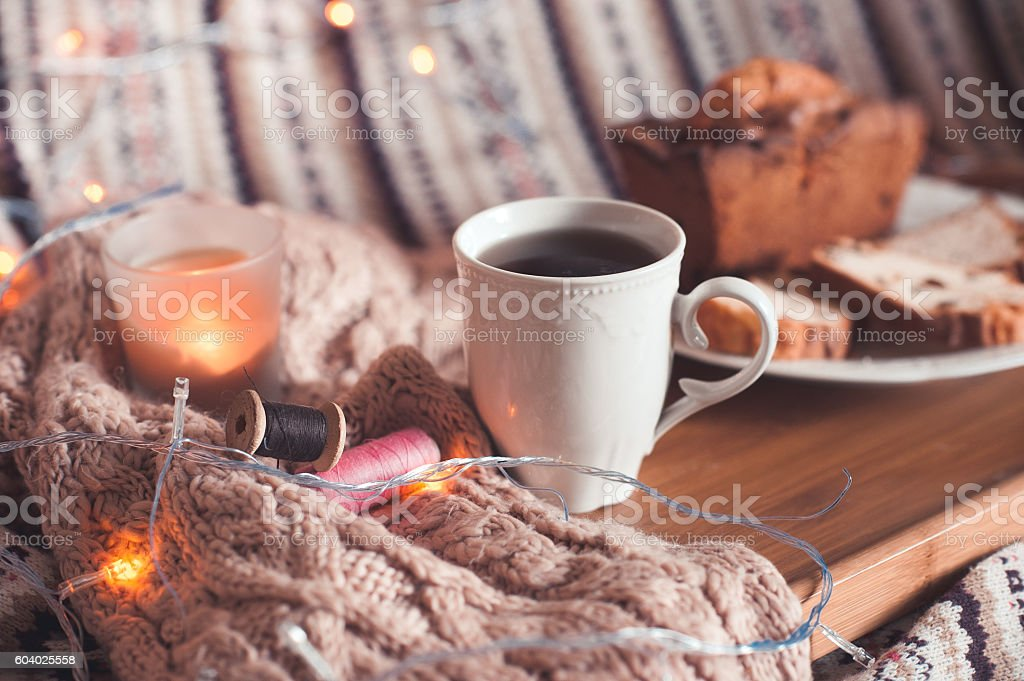 Cozy evening with cup of hot tea stock photo