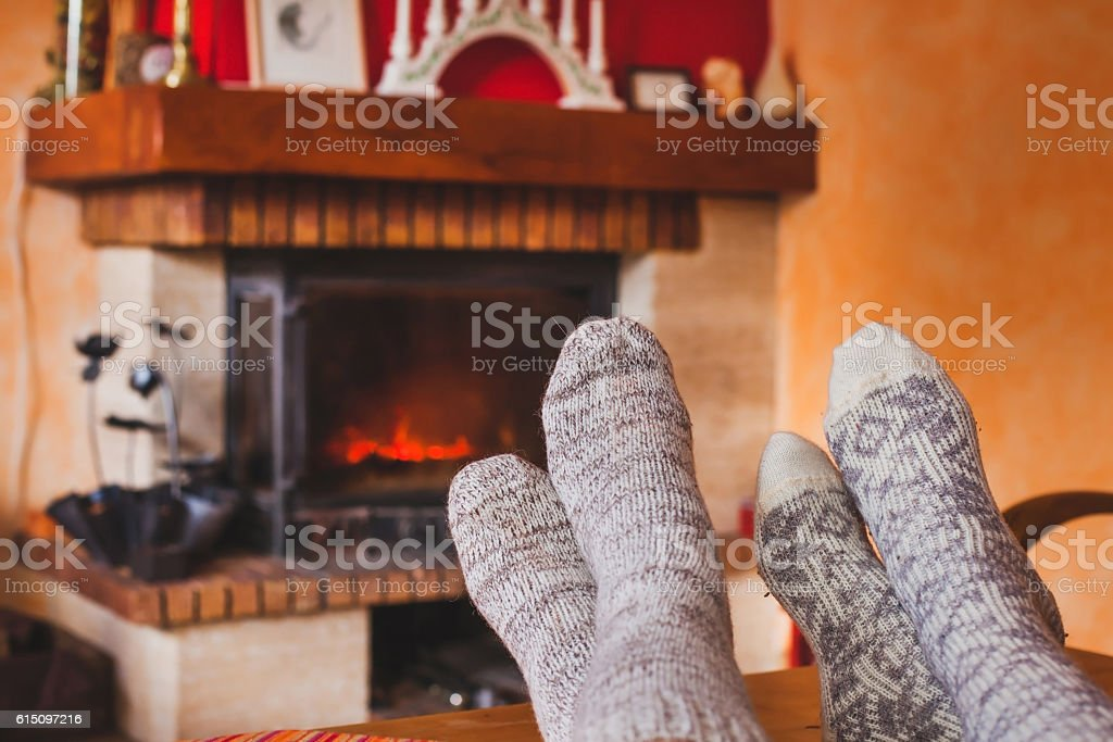 cozy family evening near fireplace stock photo