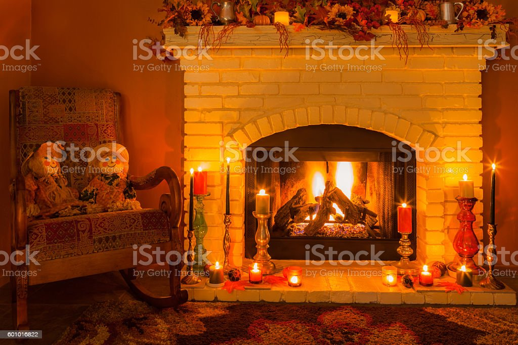 Cozy fireplace setting with rocking chair  in Autumn Colors stock photo
