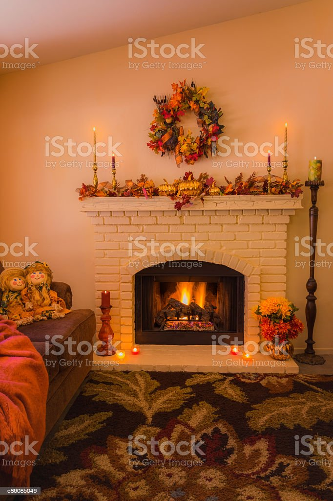 Cozy fireplace with fall decorations and candles (P) stock photo