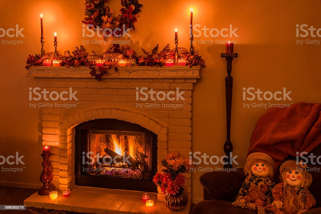 Cozy fireplace with fall decorations and candles(P) stock photo