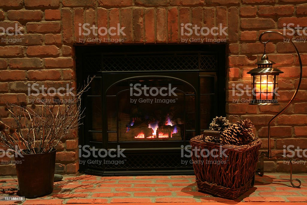 Cozy Hearth And Old Brick Fireplace At The Cottage royalty-free stock photo