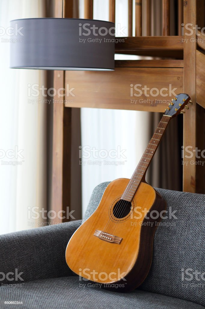 Cozy living room with guitar stock photo