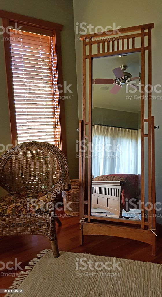 Cozy Mission Style Bedroom Through The Looking Glass stock photo