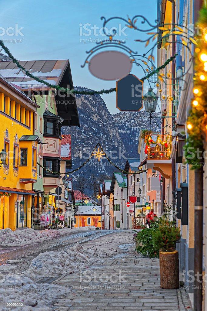 Cozy narrow street with Christmas illumination stock photo
