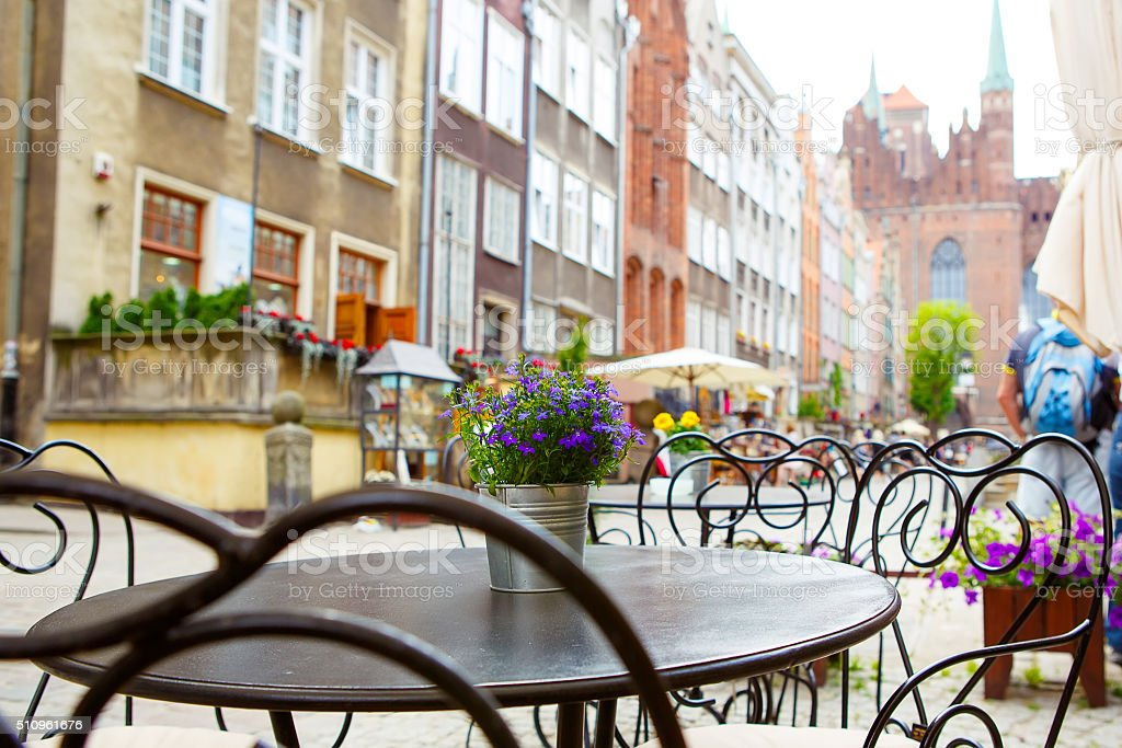 Cozy outdoor cafe in Gdansk, Poland. stock photo