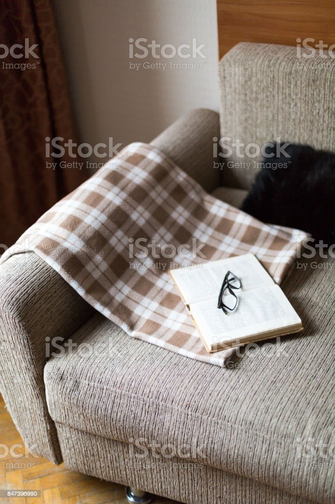 Cozy reading a book. Evening or morning time. Life style concept. stock photo