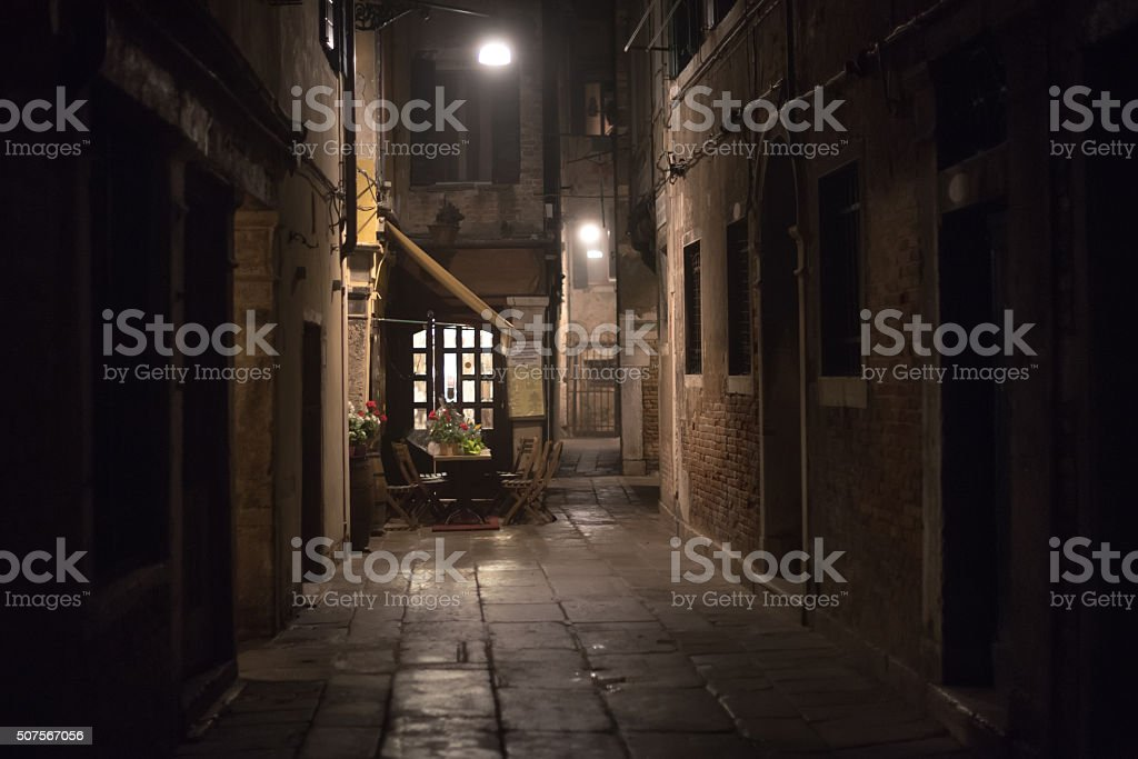 Cozy restaurant in an alley at night in Venice stock photo