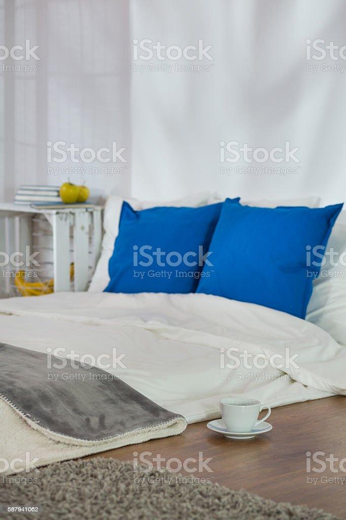 Cozy sleeping corner perfect for winter evening stock photo
