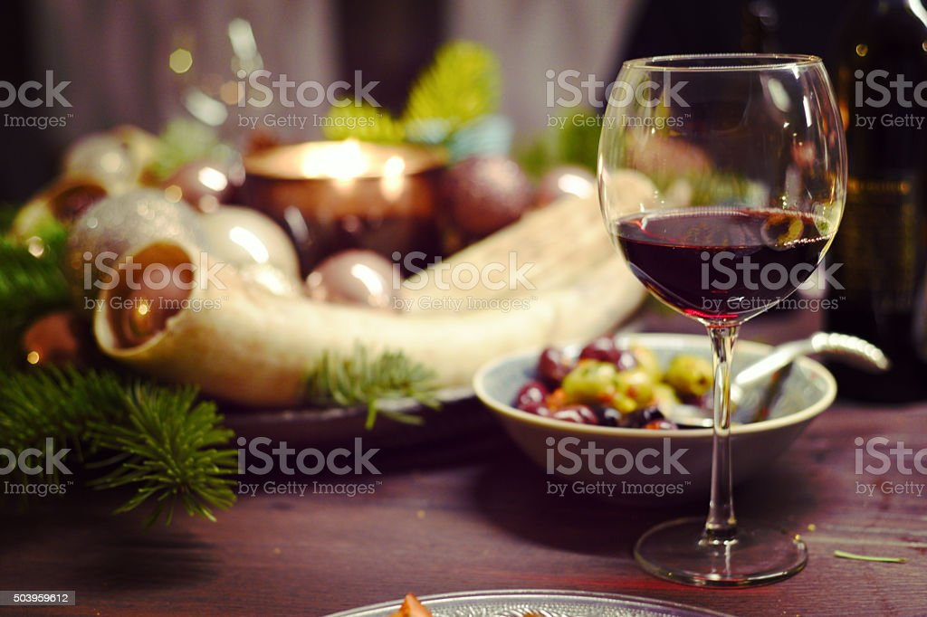 Cozy winter evening at the fireplace with some wine stock photo