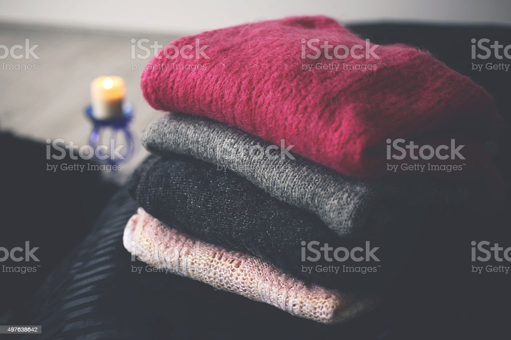 Cozy wooden sweaters stock photo