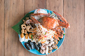 crab and seafood spicy papaya salad with vegetables