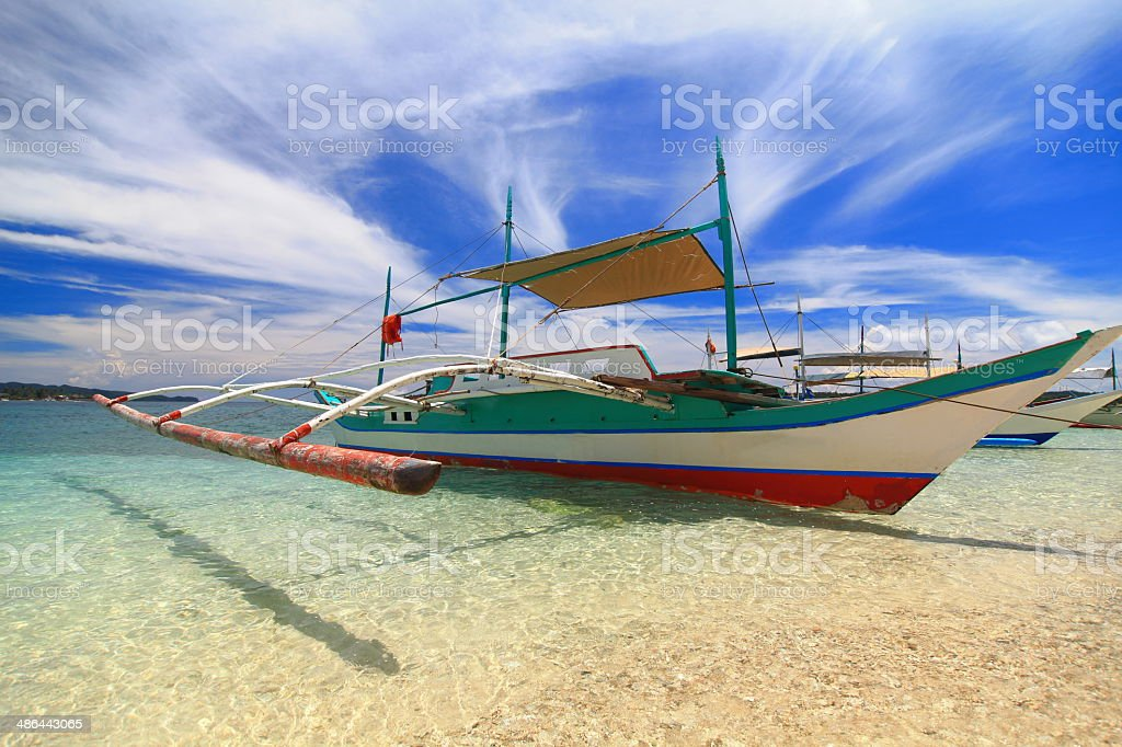 Crab boat on the sand stock photo
